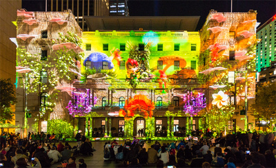 Event photographer phtographs the Vivid light display called Sydney's Hidden Stories at Customs House on the harbour foreshores during the Vivid Light Festival