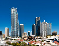 Sydney commercial architectural photographer photographs the Hilton Twin Towers against a blue sky on the Gold Coast