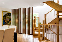 Residential architectural photographer photographs internal timber staircase and gallery for MBA award winning builder HW Barnwell